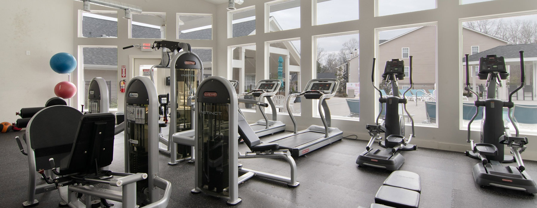 Fitness Center with large windows and cardio machines